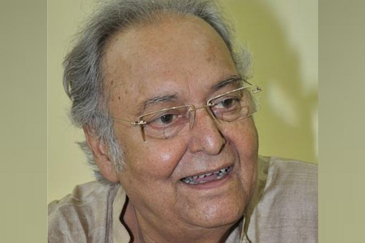 File photo of Soumitra Chatterjee smiling and looking to his left