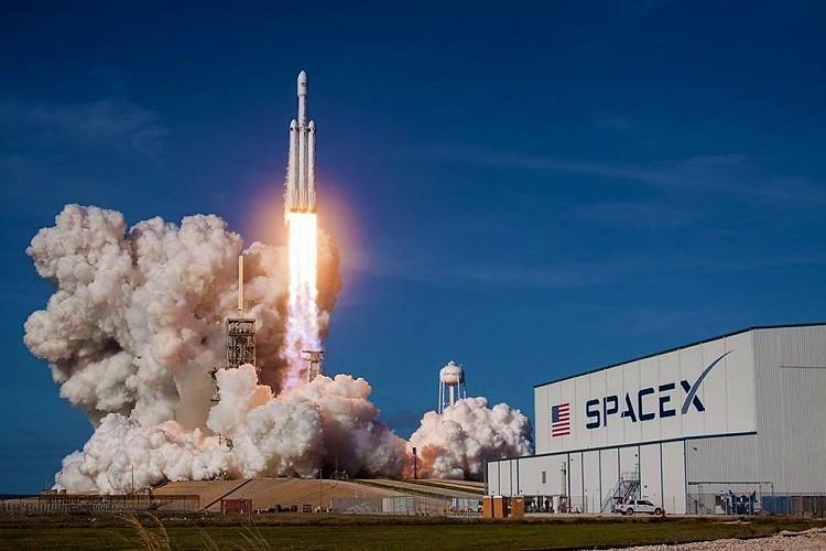SpaceX launches worlds most powerful rocket lands back two boosters successfully