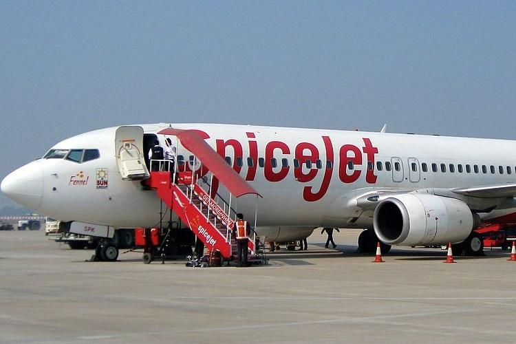 A SpiceJet aircraft at an airport in India