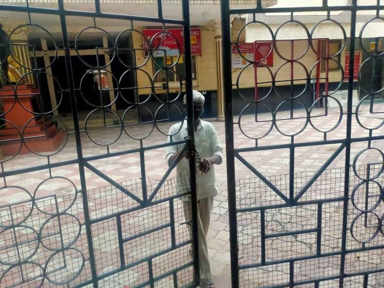 Sree mayuri theatre watchman locking the main door