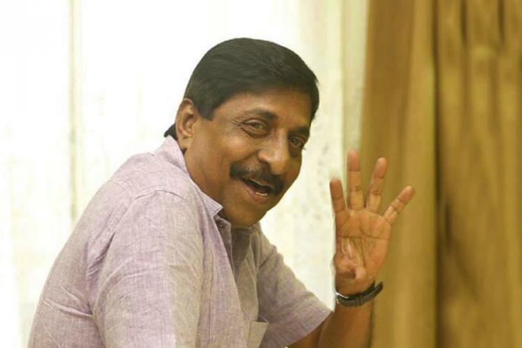 Sreenivasan smiles and waves his hand
