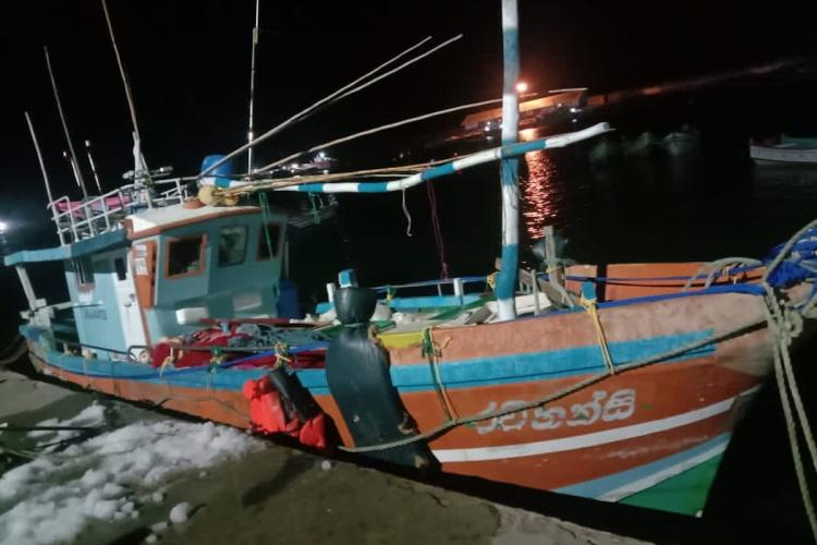 Fishing boat docked on a fishing harbour