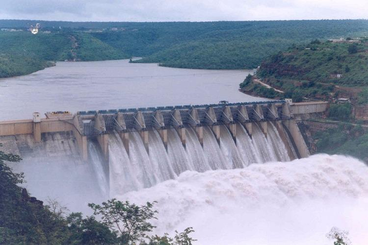 Water flows out of the gates of the Srisailam dam located on the Krishna River