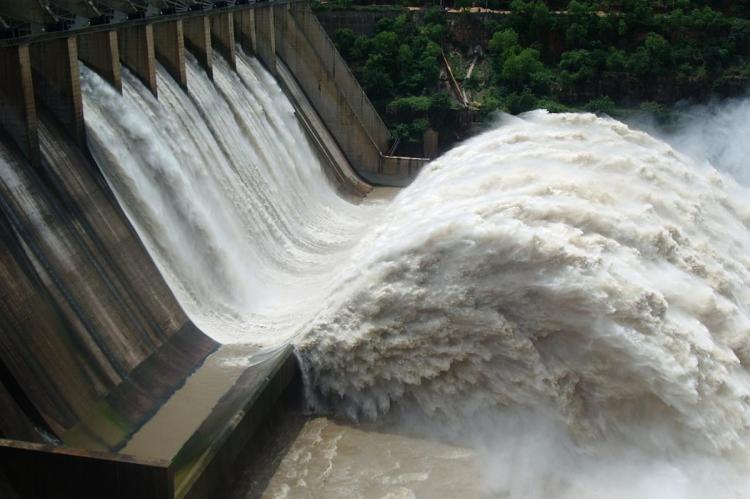 Water overflows at APs Srisailam dam authorities open crest gates