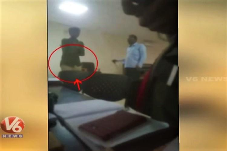 Video Official at Srisailam temple beats up tribal boy suspended