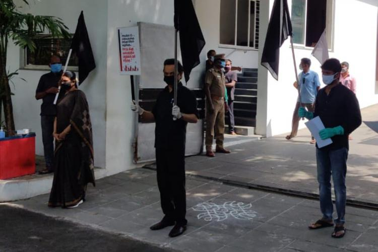 As TASMAC shops open in TN Opposition stages black flag protests from home