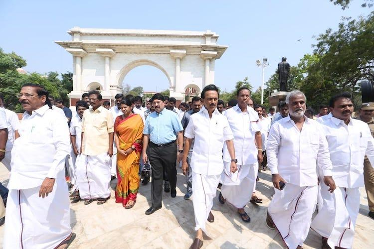 DMKs Marina victory march Stalin leads MPs and MLAs honours Anna and Karunanidhi