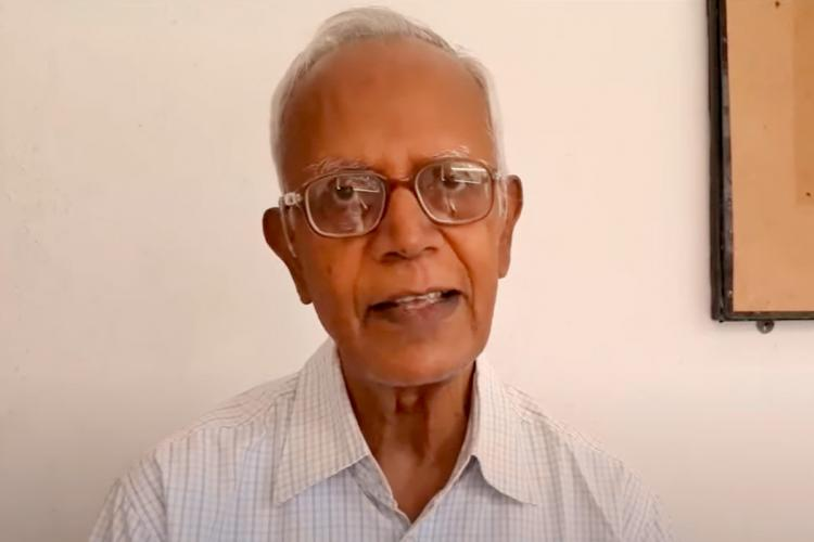 Activist Stan Swamy wearing spectacles and a white shirt and looking into the camera