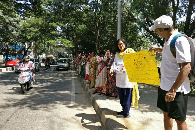 In pictures Bengalureans form human chain to protest massive steel flyover