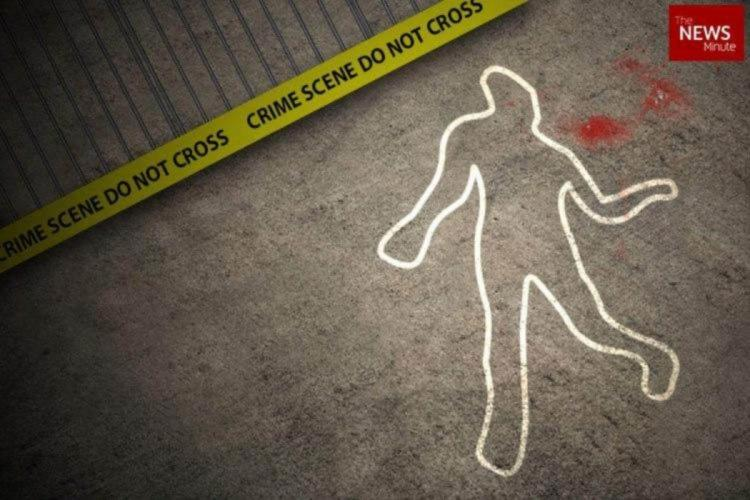 Crime scene in which the body shape was outlined by a chalk and a notice was put up saying restricted crime scene