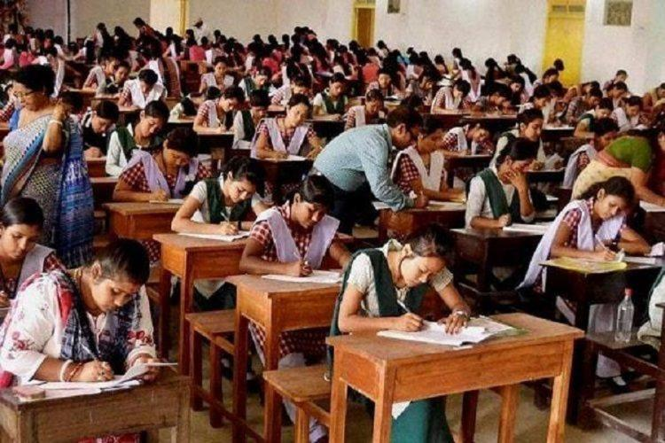students writing an exam in a hall or schools