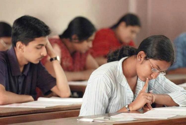 Students writing exam rep image