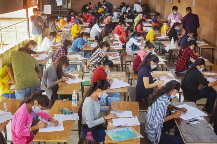 Students writing an exam wearing masks in Allahabad in September 2020
