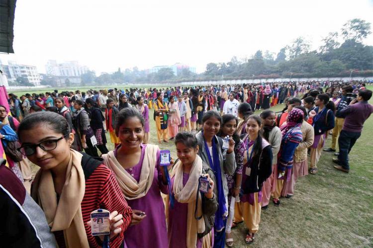 Students standing in line happy