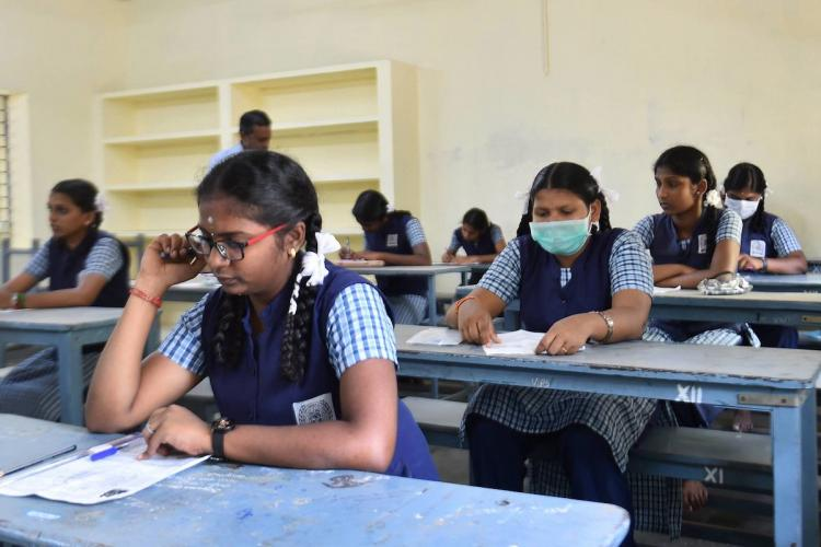 Students seated in examination hall to appear for exams
