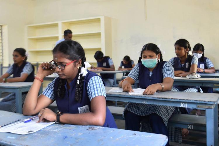 Girls writing an exam