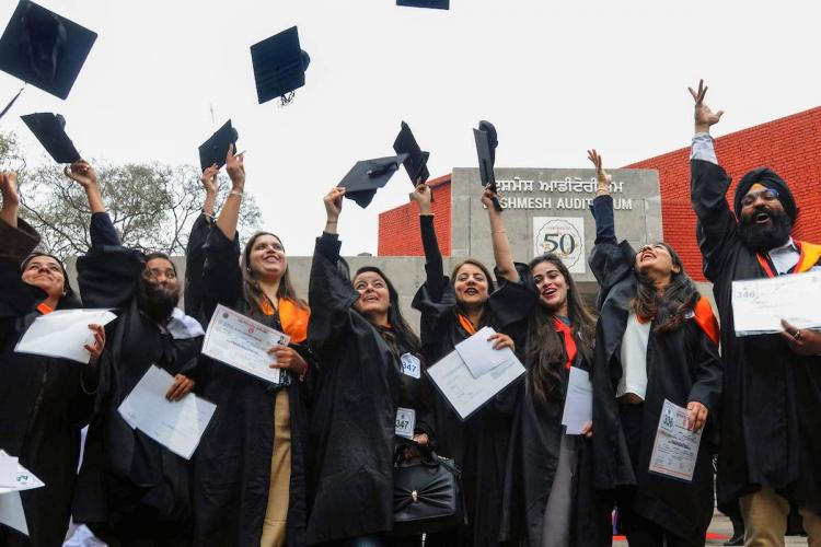 Students celebrate after receiving their degree certificates after the convocation ceremony