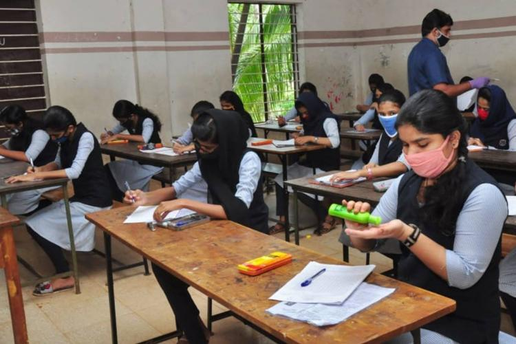 Students getting ready to attend an exam in an examination hall