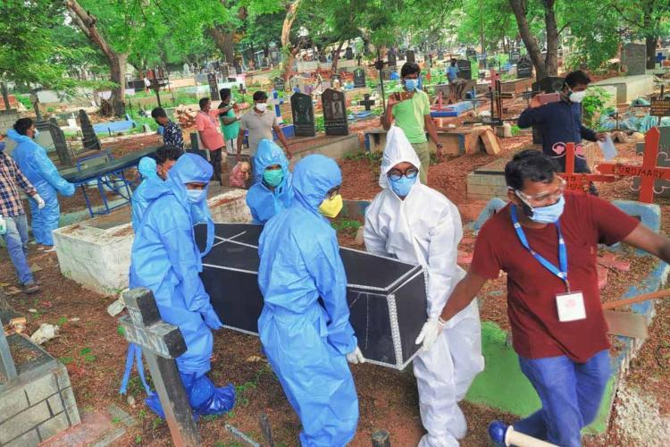 Volunteers in crematorium carrying coffin