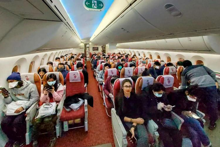 Students flying out in an aircraft during COVID-19 pandemic