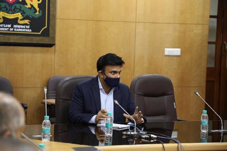 K Sudhakar wearing mask