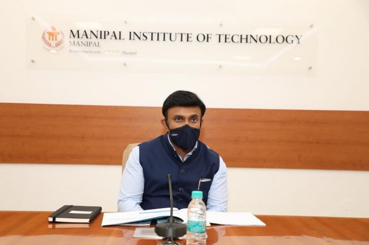 Dr Sudhakar addressing a press conference