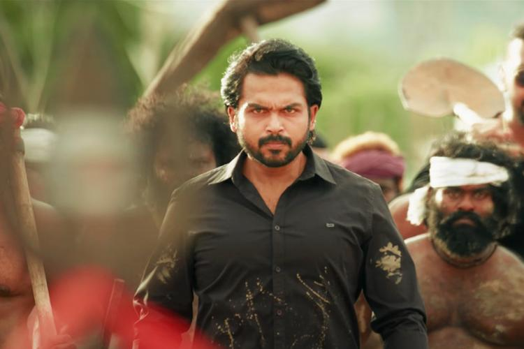 Karthi seen donning a black shirt in a still from Sulthan
