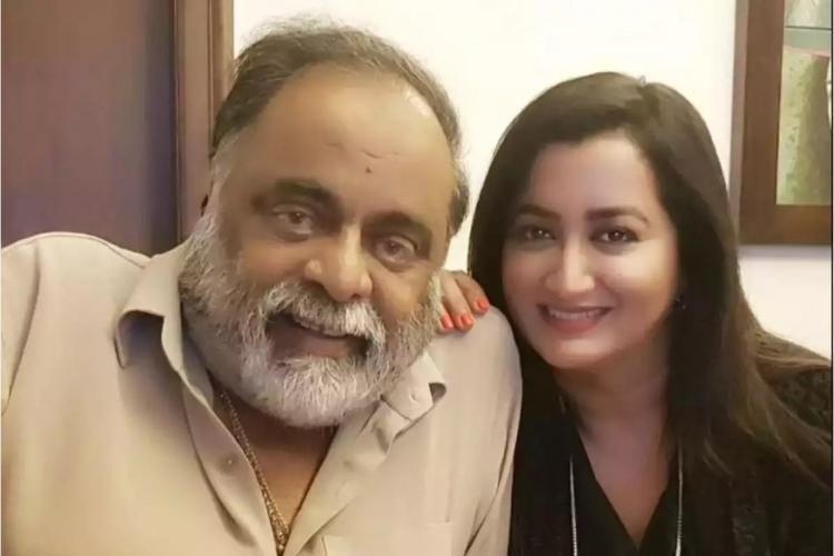 Ambareesh and Sumalatha posing smiling at the camera