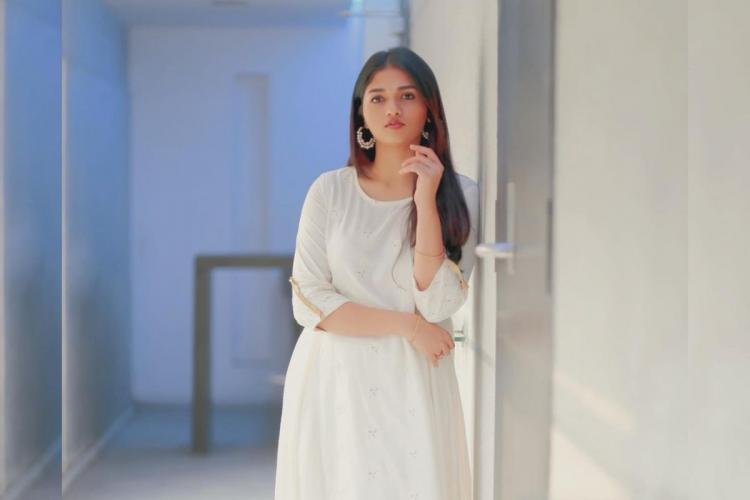 Actor Sunainaa is seen wearing a white kurta in the image
