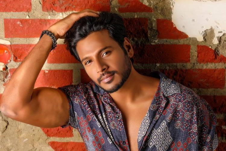 Sundeep is seen striking a pose in the image