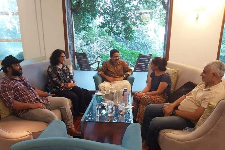 A picture of Sunita Reddy and family meeting Jomon