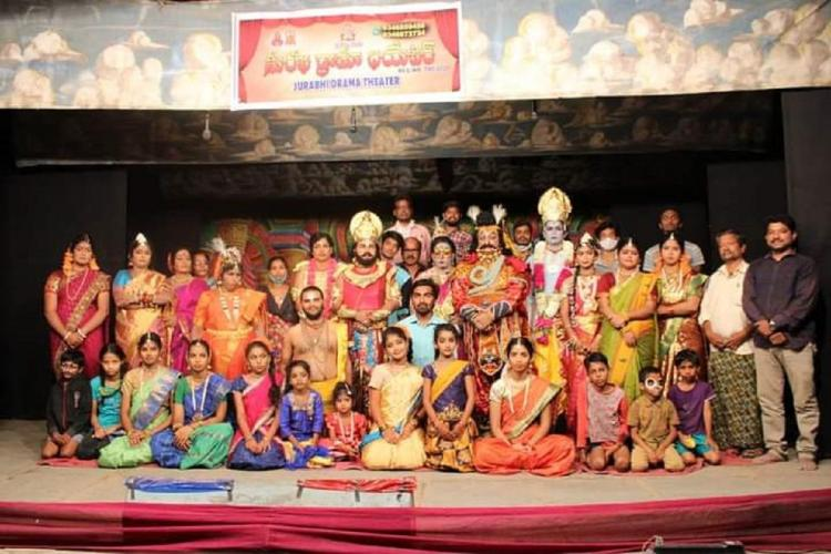 Surabhi Drama theatre group in which where all the artists were seen in various costumes posing for a picture