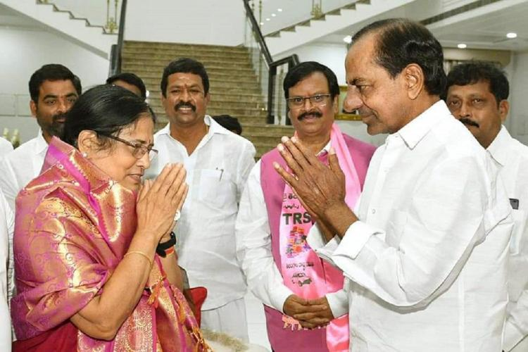 Surabhi Vani Devi is greeted by KCR, both with folded palms as four others watch