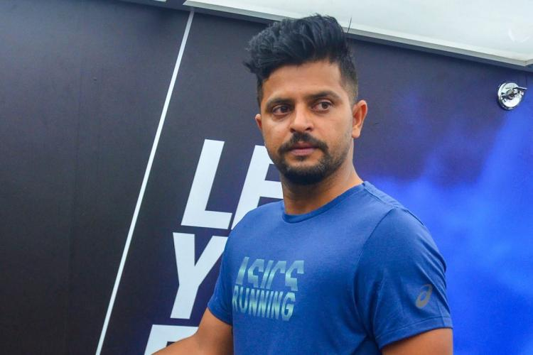 A file photo of Suresh Raina wearing a blue t shirt and looking away from the camera