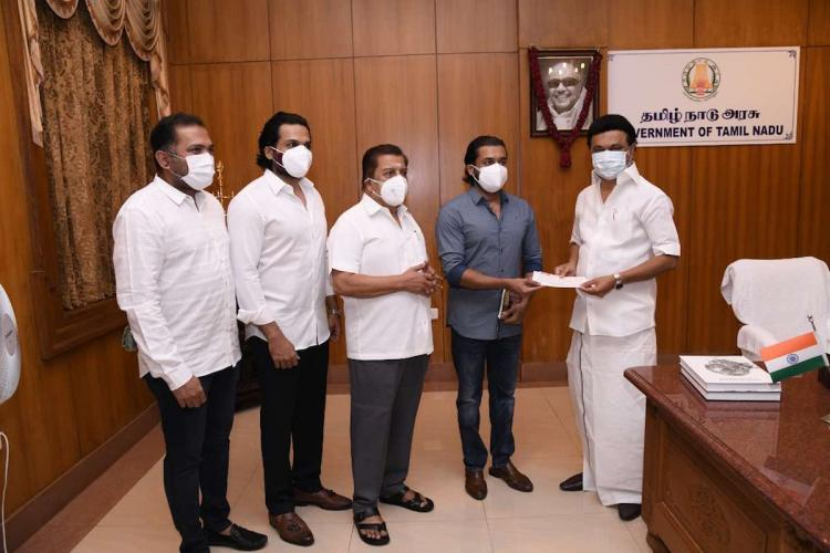 Sivakumar, Karthi and Suriya meet Tamil Nadu Chief Minister MK Stalin and hand over cheque for Rs 1 crore for the CM relief fund on May 12