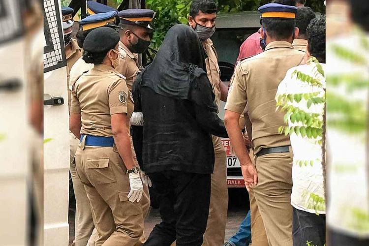 Swapna Suresh wearing black in NIA custody