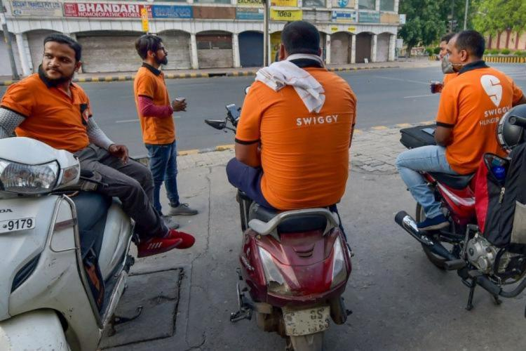 Swiggy delivery executives waiting for the order