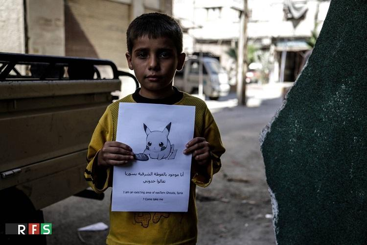 Syrian children are holding up Pokemon pictures hoping someone will find and rescue them