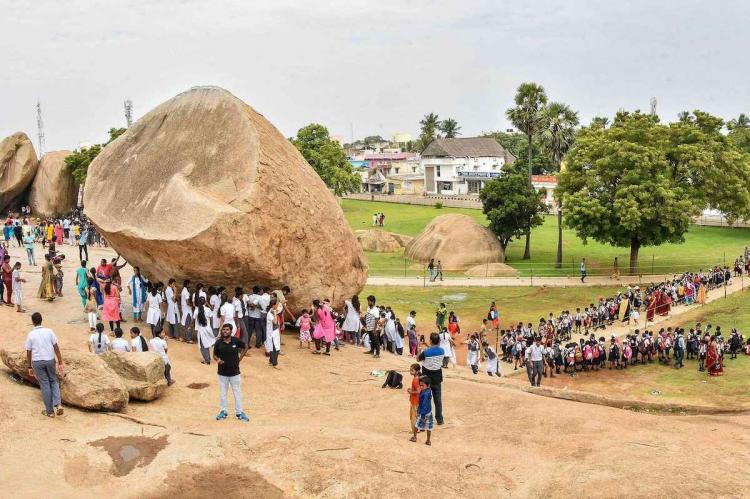Tourist site in Tamil Nadu showing lines of school children and other visitors