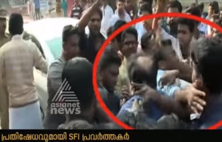 SFI activists slap and manhandle former Indian diplomat TP Sreenivasan CPIM apologises