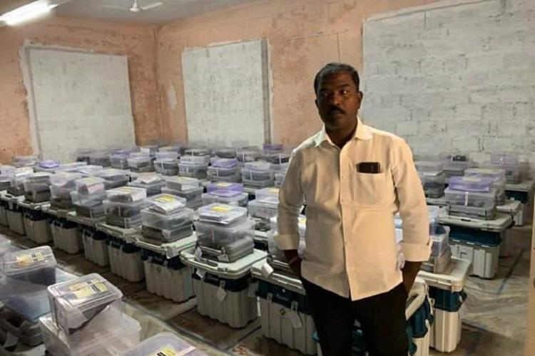 TRS poll agent held for clicking picture in EVM strong room in Telangana