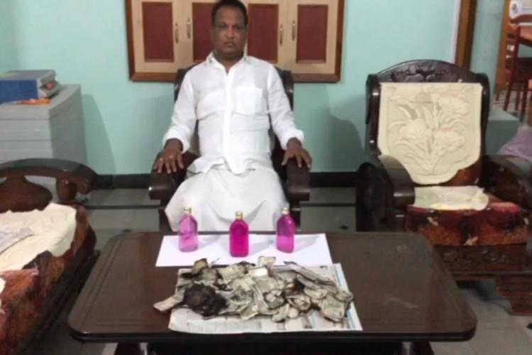 Telangana man burns Rs 5 lakh bribe money as officials knock on his door