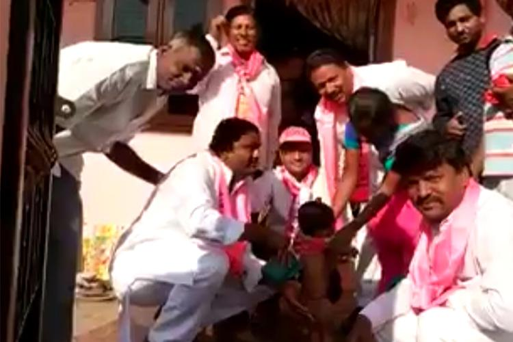 TRS Man campaigns by washing Baby