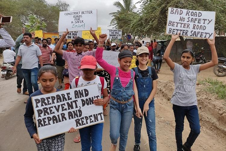 Roads between craters Blurus Whitefield residents protest over crumbling infra