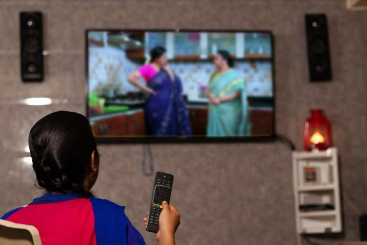 A woman watching a TV serial