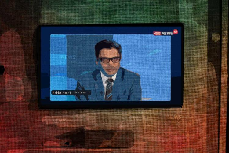 A television set mounted on a wall with a news channel playing on it