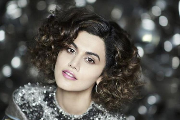 A close-up of actor Taapsee Pannu with short curly hair