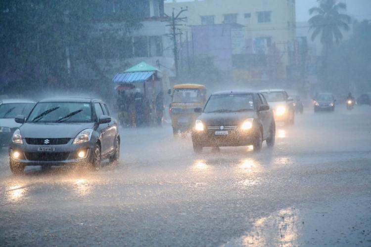 Cars driving through rainfall on the main road