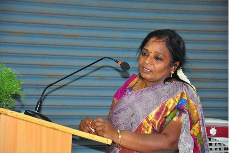 Puducherry L-G Tamilisai Soundararajan is seen wearing a colorful saree and speaking in the mike.