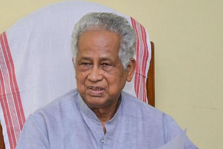 Former Assam chief minister sitting on chair
